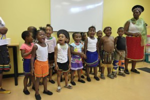 Children performing cultural song and dance in celebration of their new donation